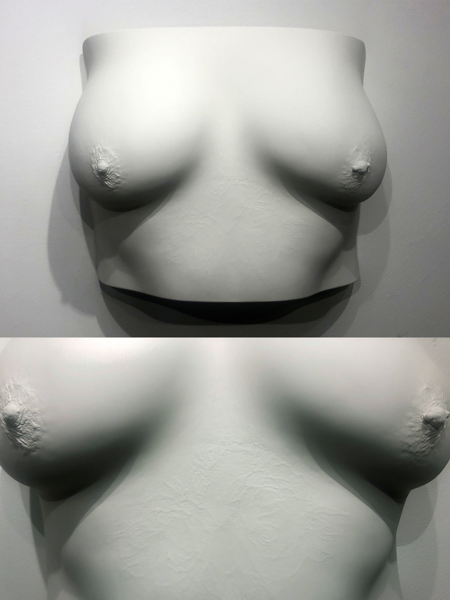 breast plaster cast with tattoo showing