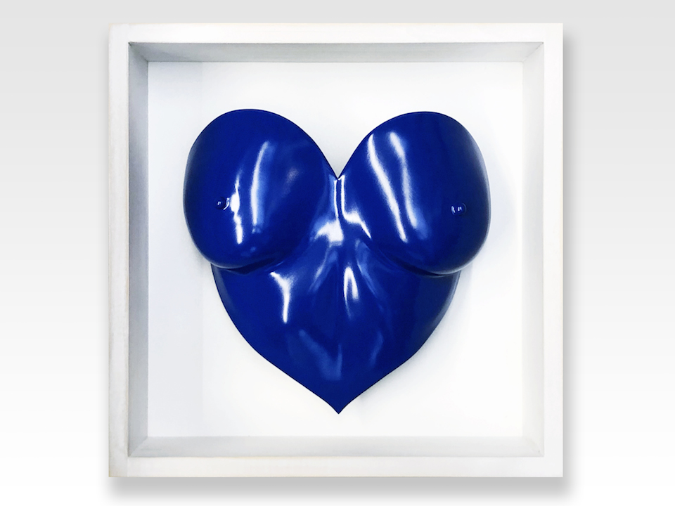 blue painted heart shaped breast cast in a white wooden frame