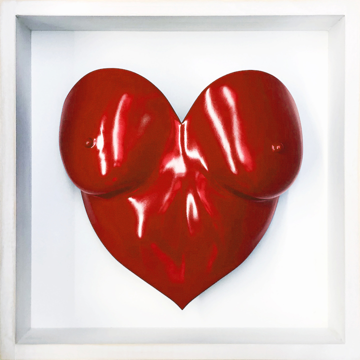 blue painted heart shaped breast cast in a white wooden frame valentines present