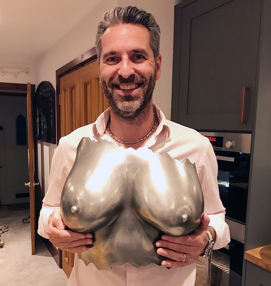 man holding breasts